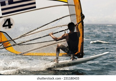 "Windsurfing athlete competing in ""Formula"" class."