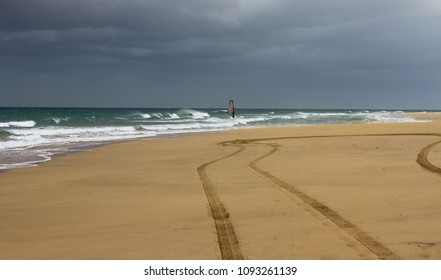 Windsurfing in the Atlantic ocean before rain. Fuerteventura, Sotavento.