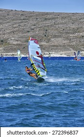 Windsurfing in the blue waters of Alacati, Cesme, Turkey