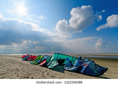 Windsurfing boards storage on a beach watersports faciity on a dune beach on the North Sea island Langeoog in Germany with clouds on a beautiful summer day. Europe.