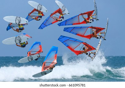 the windsurfing is doing the high jumping forward loop during training in the ocean