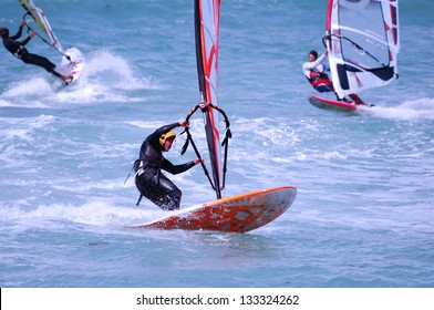 Windsurfing on a beach of Mediterranean sea