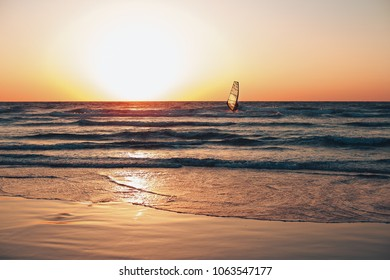 Windsurfing sails by the sea at sunset. Sunset. Sea.