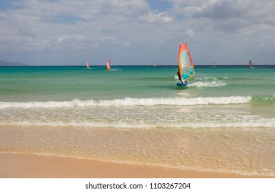 Windsurfing sails on the flat water in Atlantic ocean, Canary Islands, Fuerteventura, Spain. Extreme water sport.