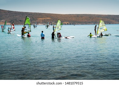 Windsurfing in the sea and the surf equipments. Dynamic Sport, people doing Windsurfing. Alacati wind Surf Paradise,  Cesme - TURKEY 09.July.2019