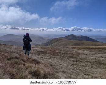 Windswept walk in the desolate mountains of Scotland
