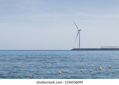 A windturbine on a dock.
