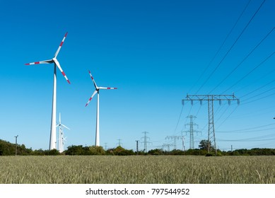 Windwheels and power transmission lines seen in rural Germany