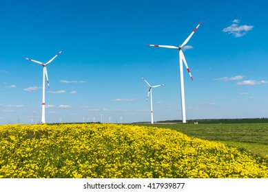 Windwheels and yellow flowers seen in rural Germany