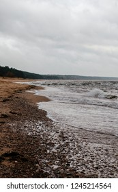 Windy autumn day by the Baltic sea. A day set aside for leisure and recreation in cold Nordic or Baltic environment. Sandy beach in fresh mood.