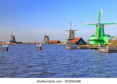 Windy lake and distant row of windmills in Zaanse Schans, Holland