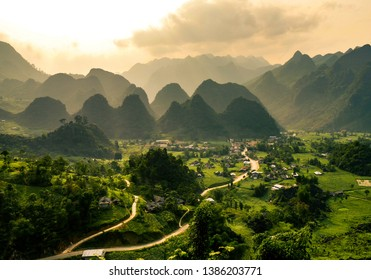 Windy roads at sunset with fog and haze at mountains in Ha Giang, Vietnam