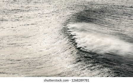 windy seascape with wave spraying