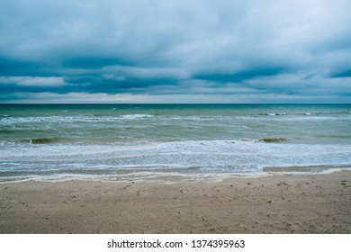 Windy storm beach sea waves with dark clouds