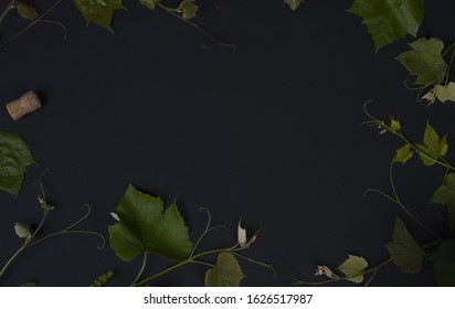 Wine. Advertising space for wine. Grape. Copy space on black background. Textures. Top view. Free space for text. Grape leaves on black background