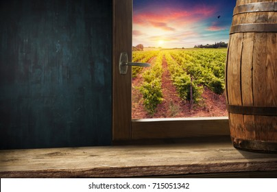 Wine barrel and grapes with vineyard on background