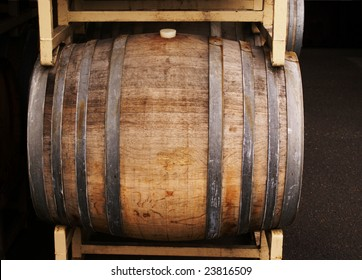 A wine barrel on a yellow rack.