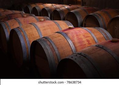 Wine barrels in an aging cellar of Ribera del Duero, Spain