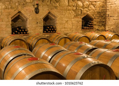 Wine barrels and bottles in a traditional cellar