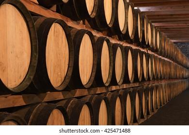 Wine barrels in wine cellar in order