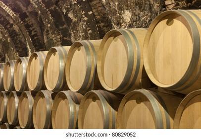 wine barrels in a cellar under the ground