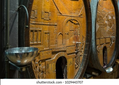 Wine barrels in the old cellar of French winery