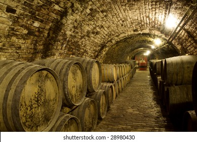 Wine barrels in the old cellar of the winery