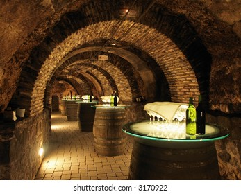 Wine barrels in the old cellar of the winery.