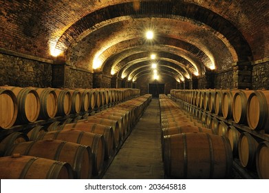 Wine barrels stacked in a cellar.