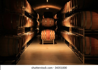 Wine barrels stacked in a cellar. Also available in vertical.