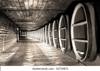 Wine barrels stock in old cellar of winery