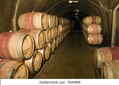 Wine barrels in a storage cave at a winery in Napa Valley