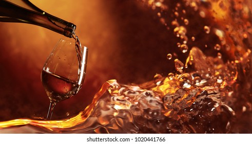 Wine being pouring into a glass. Closeup wine splashing splash. Copy space for your text.