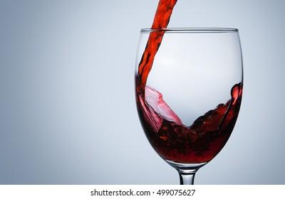 wine being pouring into a glass closeup wine splashing splash