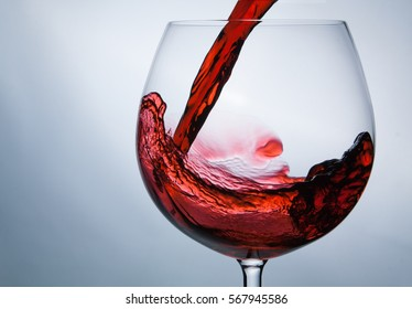 wine being pouring into a glass closeup wine splashing splash
