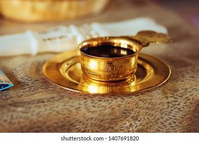 Wine, the blood of God in the cup before the wedding ceremony in the church. Divine Liturgy. -