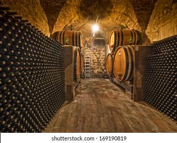 wine bottle and barrels in winery cellar