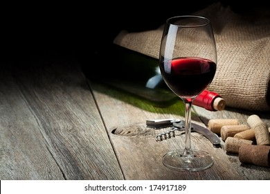 wine bottle and cork and glass with red wine