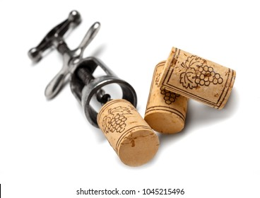 wine bottle corks with vintage corkscrew isolated on white