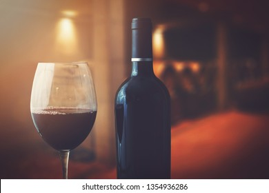 wine bottle and glass in wine cellar