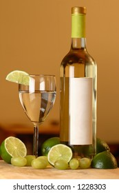 A wine bottle with limes.