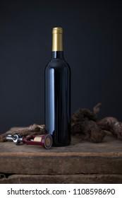 Wine bottle on a Old wood case on a black Background
