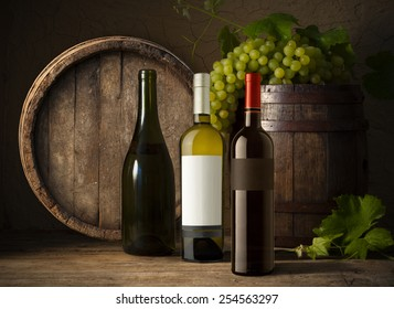 wine bottle  on wooden barrel