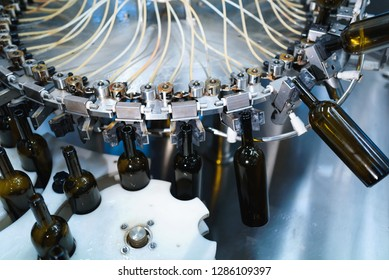 wine bottles in automated machine at factory