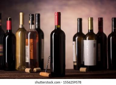Wine bottles collection on dark background