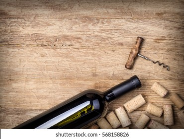 wine bottles and corks on wooden background
