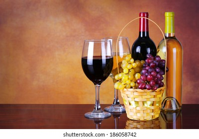 Wine Bottles and Glasses of Wine. Basket of Fresh Grapes