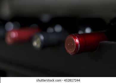 Wine bottles lined up in a rack