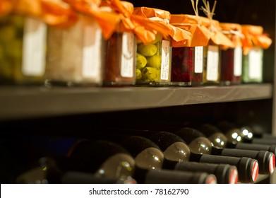 Wine bottles and mason jars in a shelf