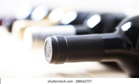 Wine bottles in a row isolated on a white background